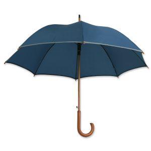 Dieser Holzregenschirm ist mit einem Reflektorband ausgestattet und zusätzlich individuell bedruckbar.